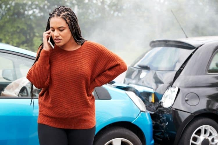 A woman making a phone call after she got into a car accident in florida